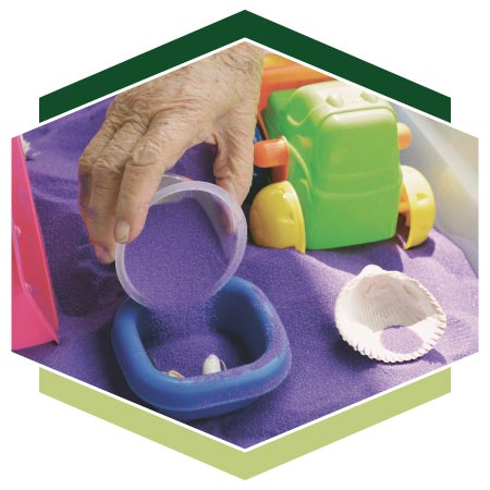 Close up of Montessori activities using sand