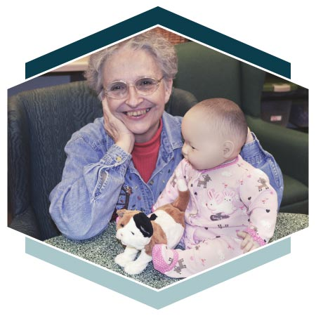 Alzheimer's resident poses with baby doll