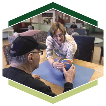 Instructor Marcy working with an Alzheimer's resident