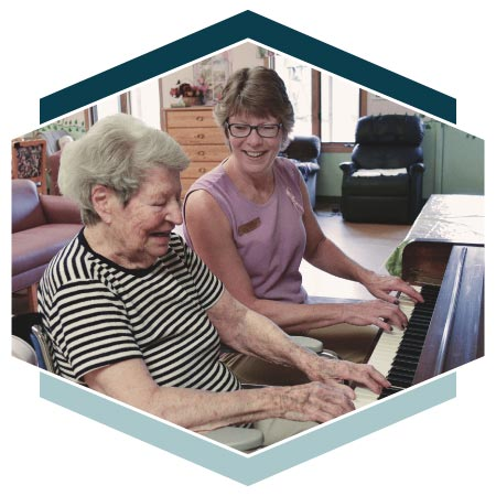 Alzheimer's resident and instructor play piano